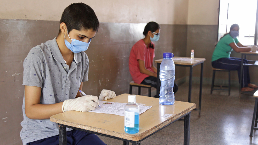 Sep 13, 2020: Candidates appears in National Eligibility cum Entrance Test (NEET) exam, amid coronavirus pandemic, at an examination center in Beawar, Rajasthan.