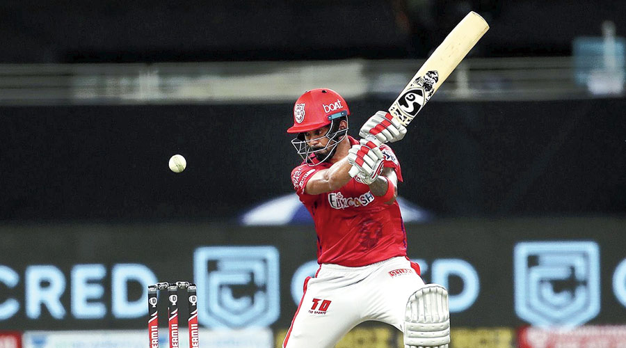 Kings XI Punjab skipper KL Rahul plays a shot en route to his 69-ball 132 against RCB in Dubai on Thursday.