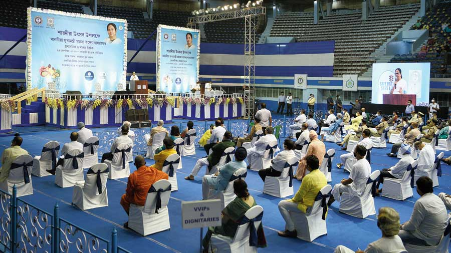 Chief minister Mamata Banerjee addresses the Puja coordination meeting at the Netaji Indoor Stadium on Thursday.