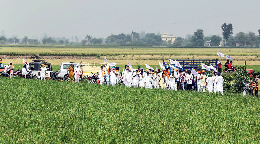 Farmers on their way to block railway tracks in Punjab on Thursday.