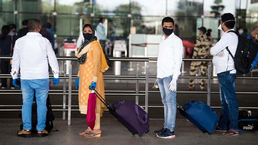 Passengers queue at Mumbai airport, May 2020.
