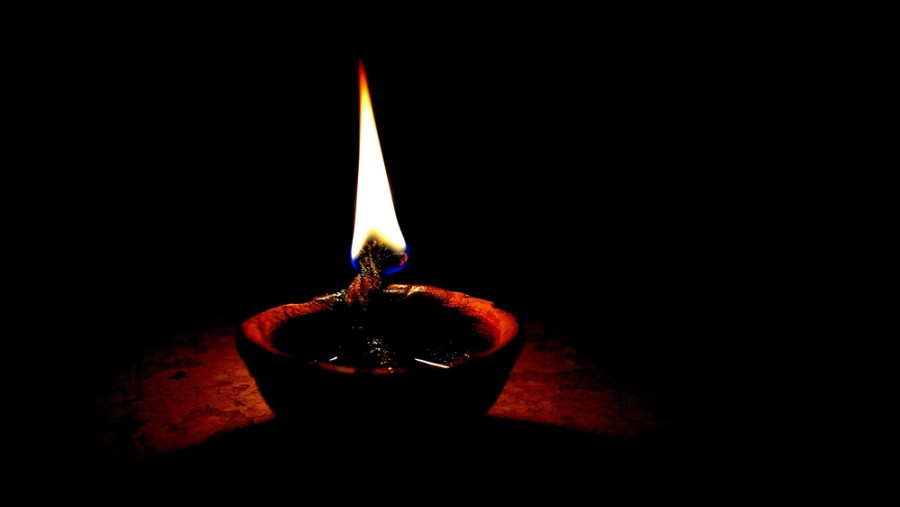 Her clothes caught fire from a diya she had  lit while offering her prayers.