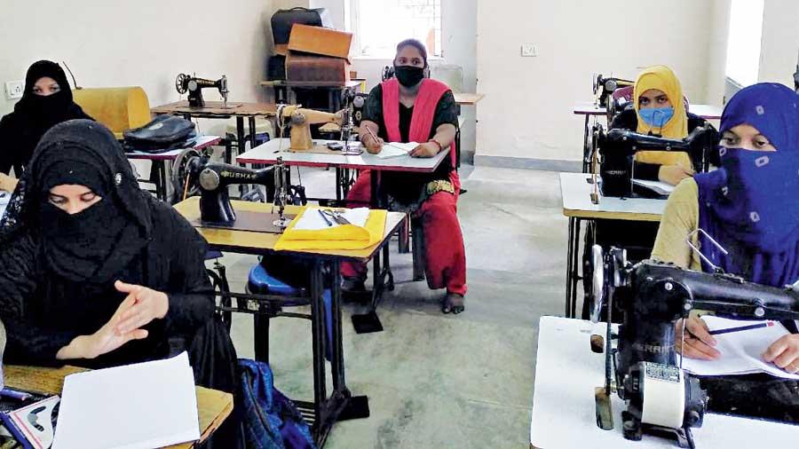 Women in a Kolkata Mary Ward Social Centre tailoring class