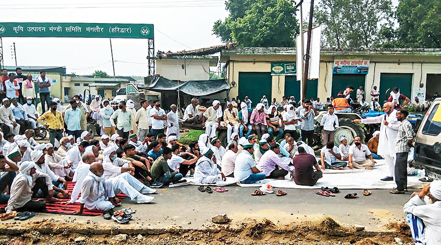 Farmers protest near the APMC market in Hardwar in Uttarakhand on Friday.