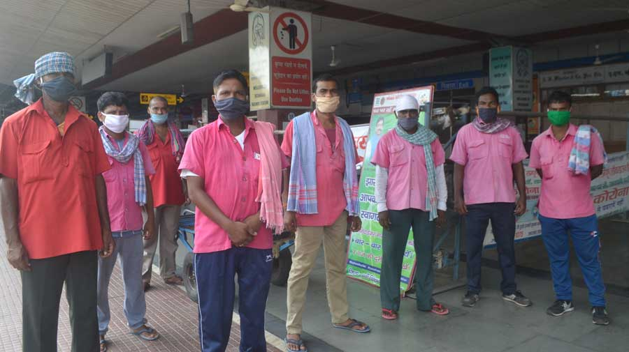 Porters at Tatanagar station in Jamshedpur on Sunday.