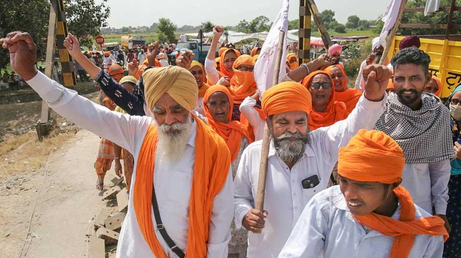 Farmers block railway tracks during Rail Roko Andolan against the newly introduced farm bills at Devi Dass Pura village, 20km from Amritsar, on Sunday.