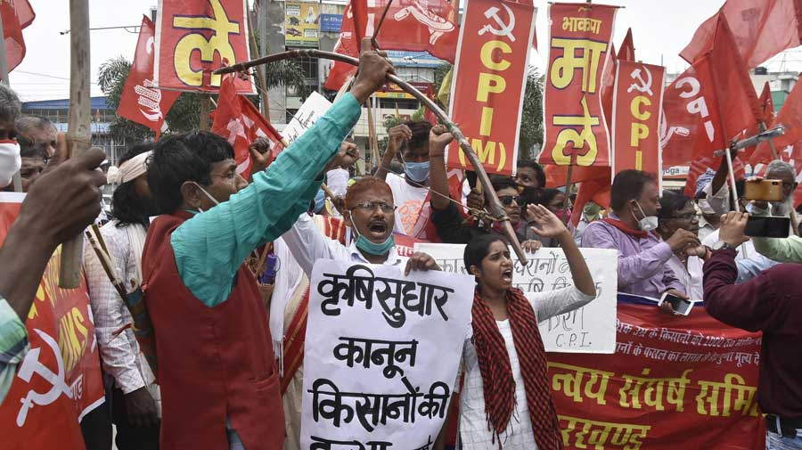 Communist Party of India (Marxist-Leninist) activists during a demonstration against the farm bills in Ranchi on Friday.