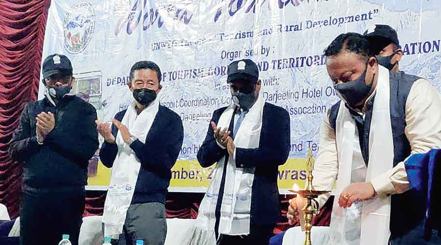 Anit Thapa lights up the lamp at the World Tourism Day programme in Darjeeling on Sunday