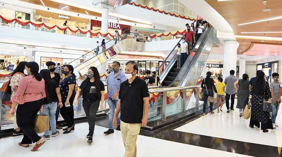 Shoppers at South City Mall on Sunday evening