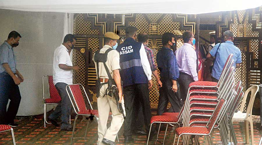 Investigators search the residence of former Assam DIG PK Dutta in Guwahati on Thursday.