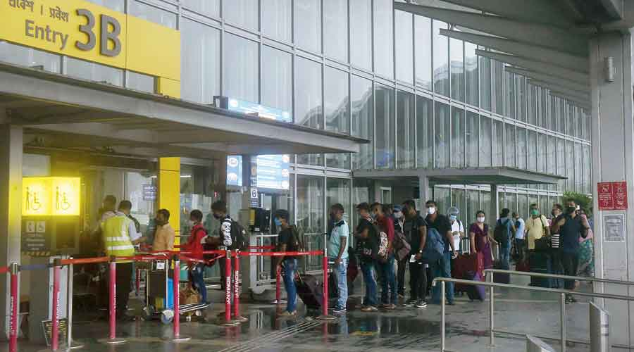 A long queue at Gate 3B of the airport terminal on Monday afternoon. Passengers who collect boarding passes from airline counters at Gate 3C tend to queue up at Gate 3B  or Gate 3A to enter the terminal, instead of other gates