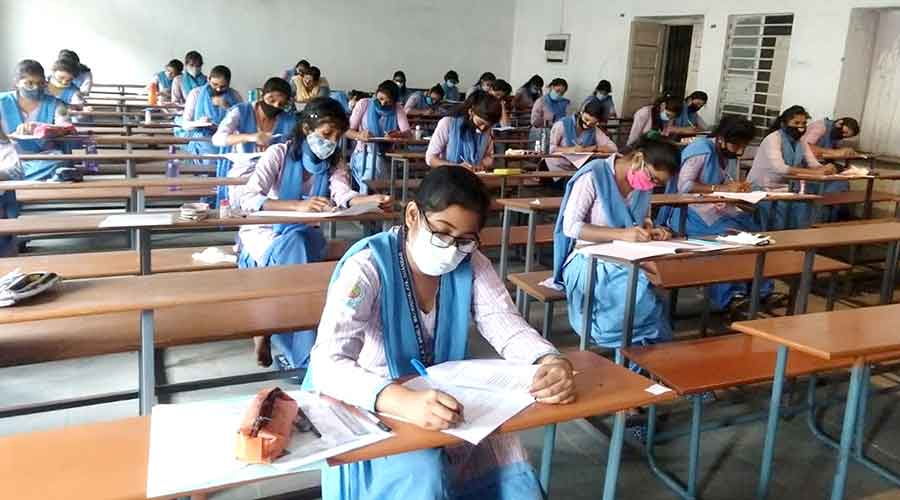 Students take their final semester exams at SSLNT Women's College in Dhanbad