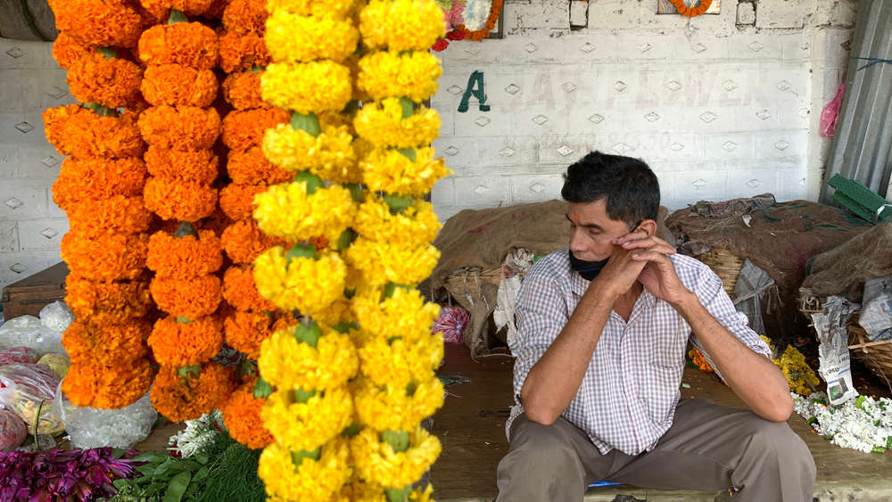 A flower vendor waiting for customers in Guwahati, August 2020.