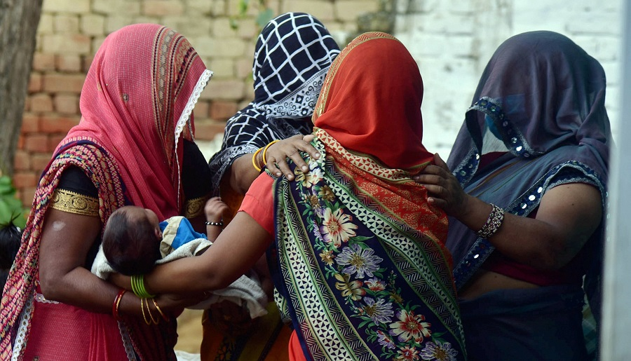 Relatives mourn the death of the rape victim in Hathras.