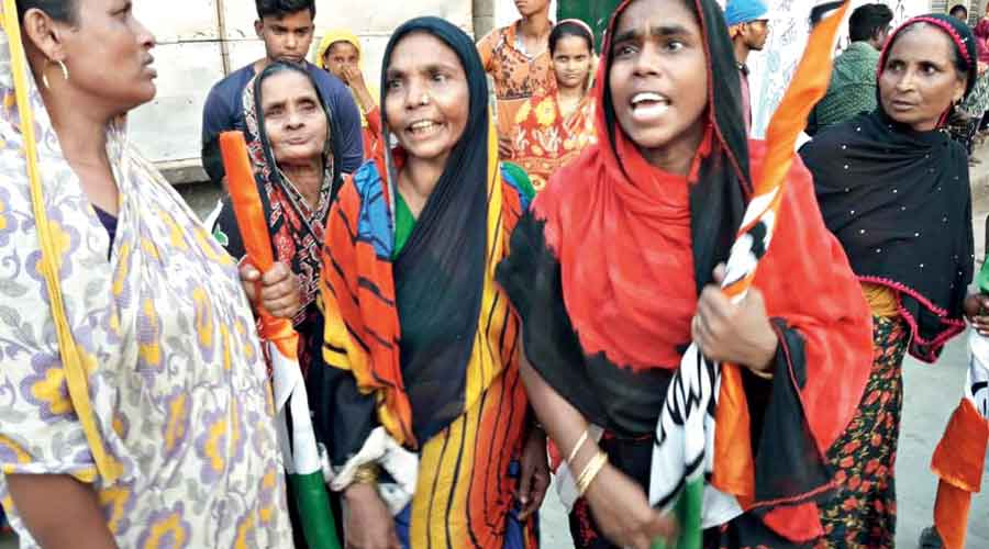 "Women holding Trinamul flags raise slogans against Suvendu while his followers retort with ""Jai Shri Ram"" chants on Monday"