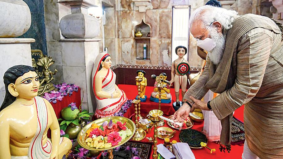 Prime Minister Narendra Modi offers prayers at the Hari temple of Guruchand at Orakandi Thakurbari, in Bangladesh, Saturday, March 27, 2021.