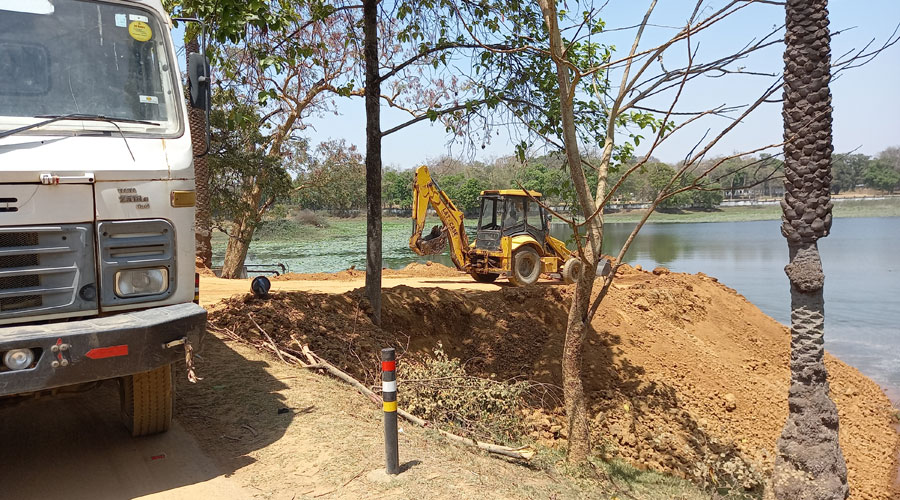 JCB in action to fill a portion of bada jheel in Hazaribagh on Friday.