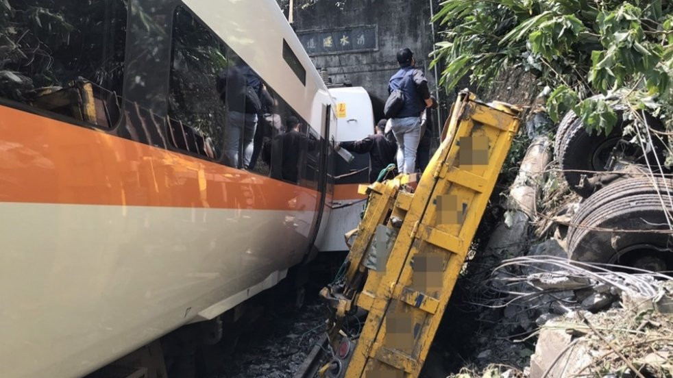 Images from the scene show some carriages ripped apart by the impact with others crumpled hindering rescuers in their efforts to reach passengers