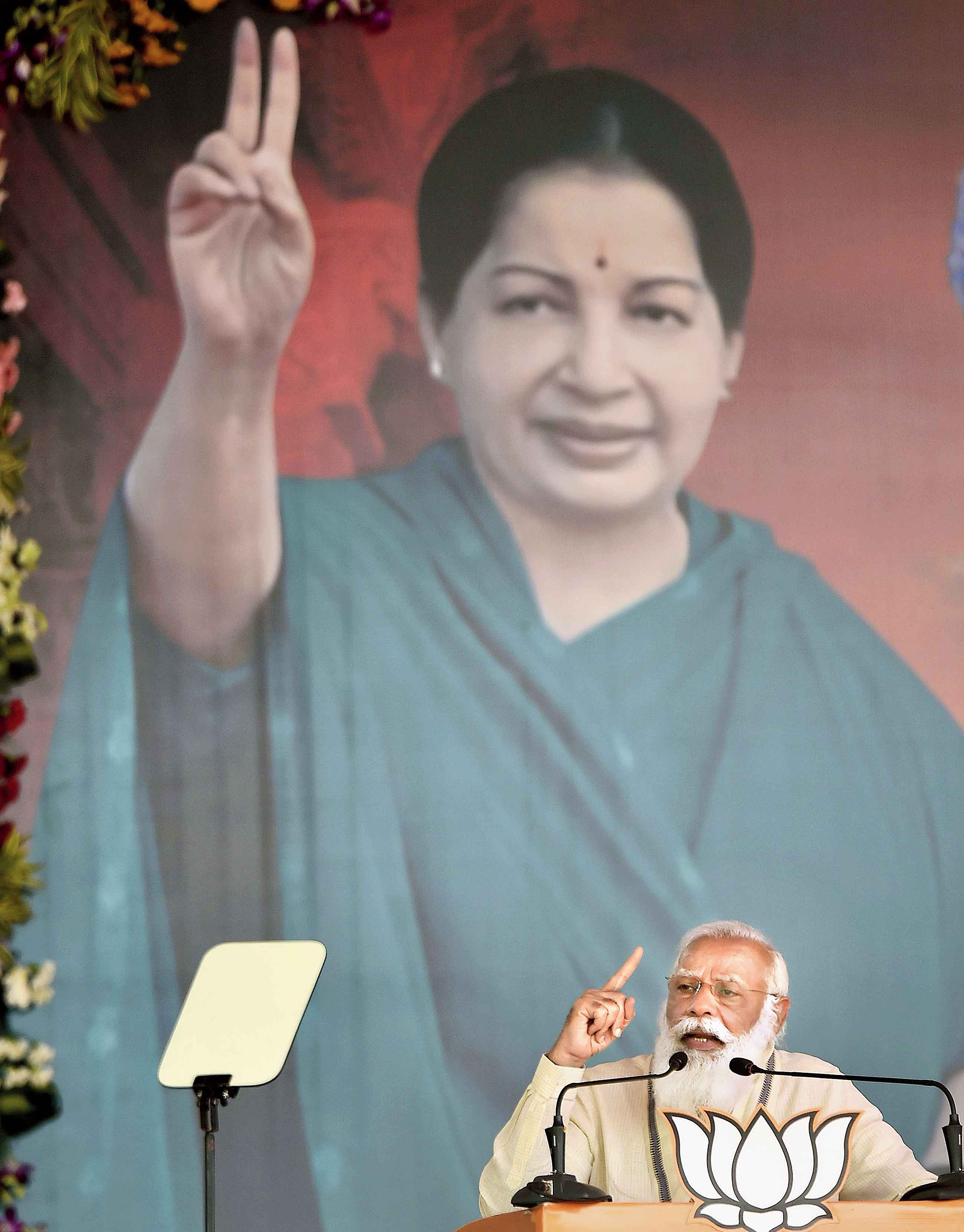 With a portrait of the late Jayalalithaa providing the backdrop, Prime Minister Narendra Modi campaigns for the BJP and its allies, which include the AIADMK, in Madurai in Tamil Nadu on Friday