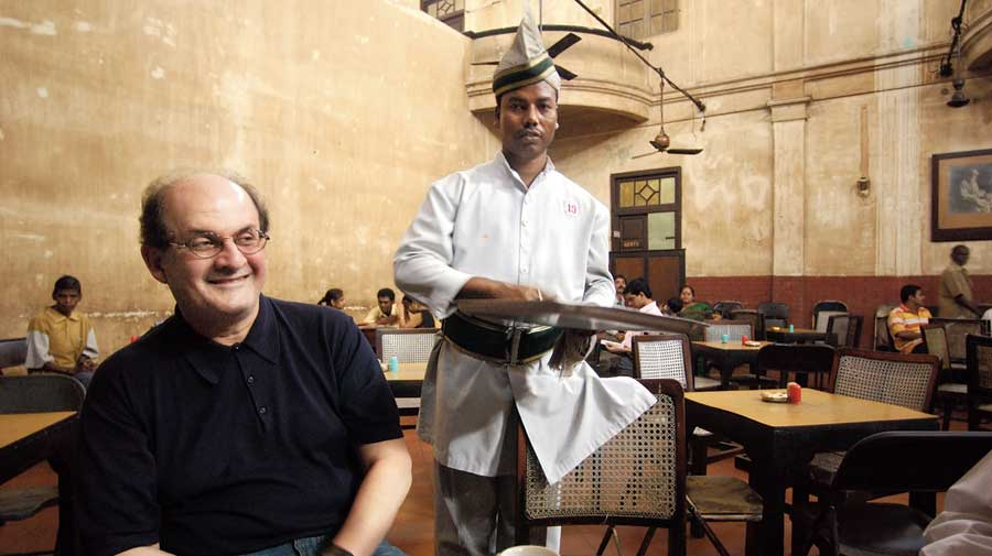 """Salman Rushdie at the Indian Coffee House on College Street in Calcutta in 2004. Last month, in the run-up to the Bengal elections, the Coffee House had witnessed an attempt by the Right wing to usurp the platform for debate and free-thinking. As Rushdie has now written in The Guardian about finding """"hope in the determination of India's women and college students to resist"""" sectarianism and """"dismiss the darkness"""", it was a young group led by a woman who had stood up to the rabble-rousers last month in the Coffee House."""