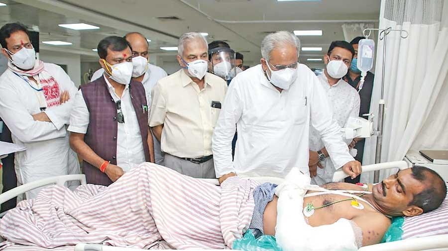 Chhattisgarh chief minister Bhupesh Baghel visits an injured CRPF jawan in a Raipur hospital on Sunday.