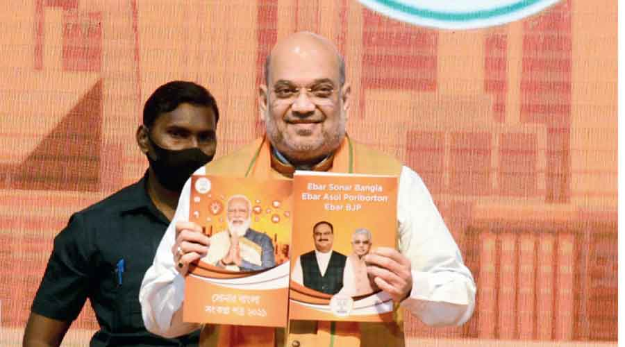 Union home minister Amit Shah releases the BJP manifesto for Bengal elections in Calcutta.