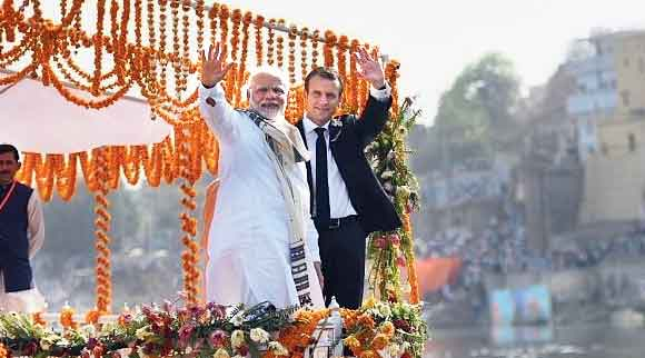 "Modi with current French President Emmanuel Macron in 2018. The Mediapart report said ""the affair potentially threatens Hollande and Macron"""