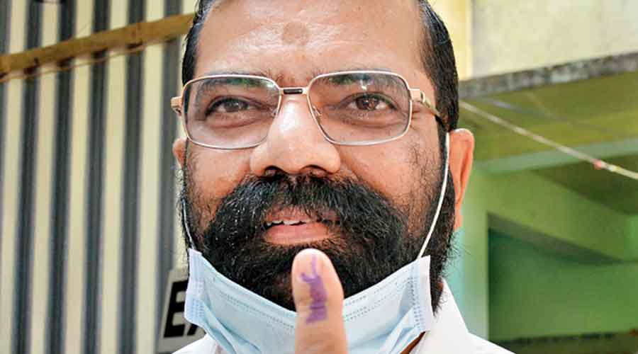 AASU chief adviser Samujjwal Kumar Bhattacharya after casting his vote in Guwahati
