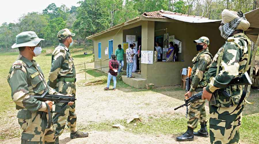 BSF personnel keep vigil at a polling station in Wayanad, Kerala, on Tuesday
