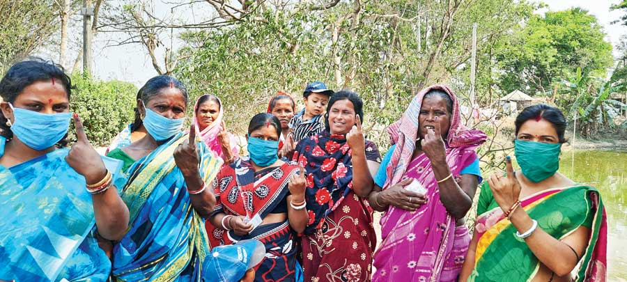 The eight women after casting votes at a booth at Khordda-Kanpur Primary School on Tuesday.