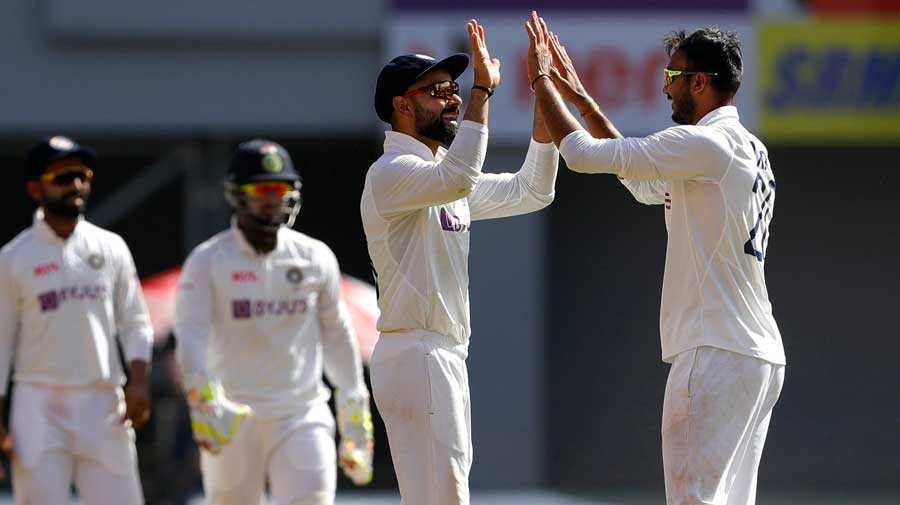 Axar Patel celebrates with Virat Kohli on Day 1 of the final Test against England in Ahmedabad.