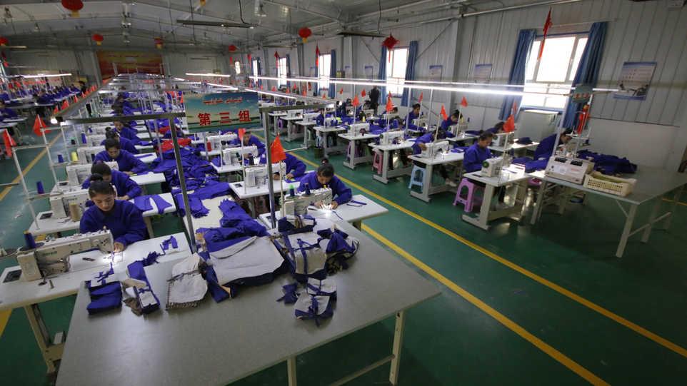 Uighur women work in a cloth factory in Hotan county, Xinjiang province, China.