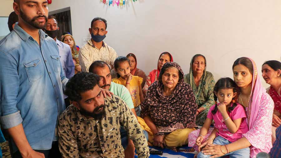 Family members of CRPF commando Rakeshwar Singh Manhas, who is missing from the site of encounter with the naxals in Chhattisgarh, at their residence in Jammu on Monday.