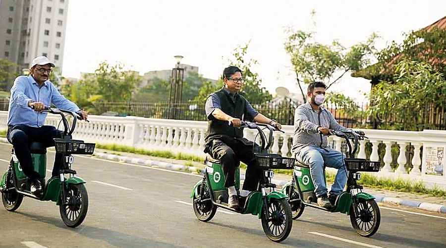 Hidco chairman and managing director Debashis Sen (left) test rides an e-bike