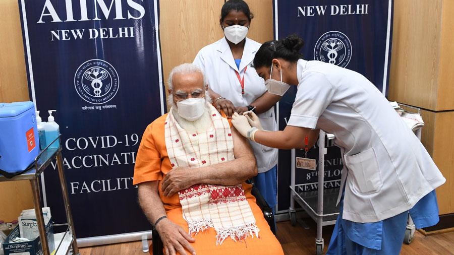 Narendra Modi receives the second dose of coronavirus vaccine, in AIIMS, New Delhi on Thursday.