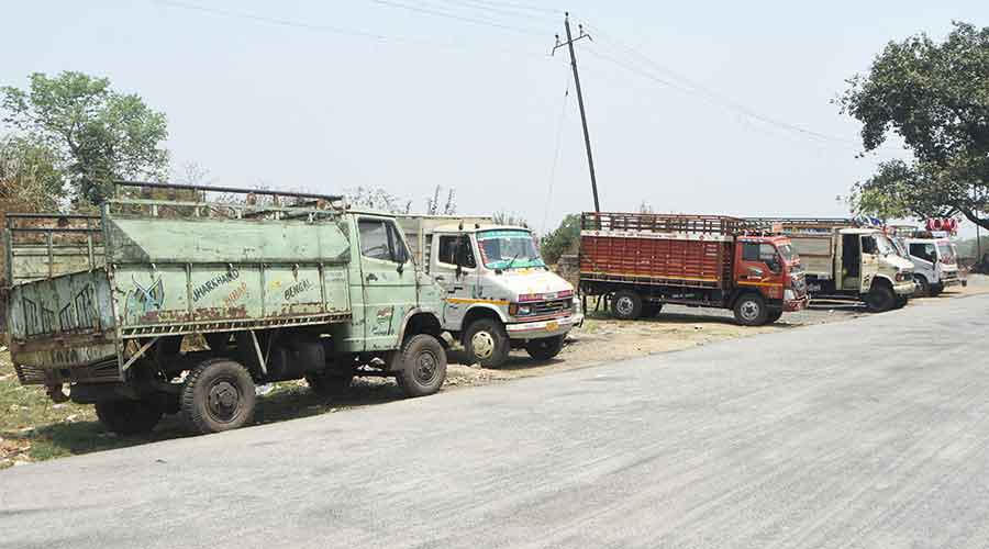 Vehicles carrying goods at Jharkhand-Bengal route (permit) stand at DAV School ground in Purana Bazar in Dhanbad on Thursday.