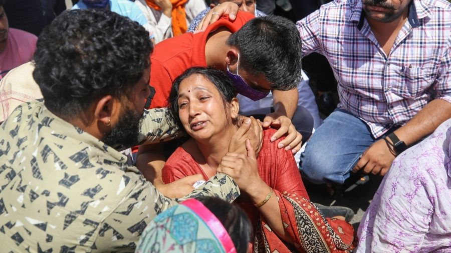 Sister of  Rakeshwar Singh Manhas demands his release on Wednesday during a protest in Jammu and Kashmir.
