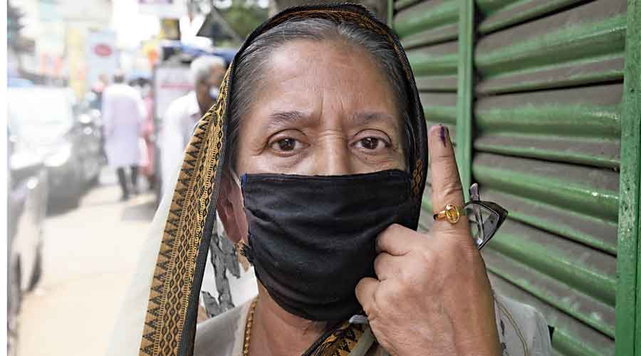 Chatterjee shows her inked finger after casting her vote