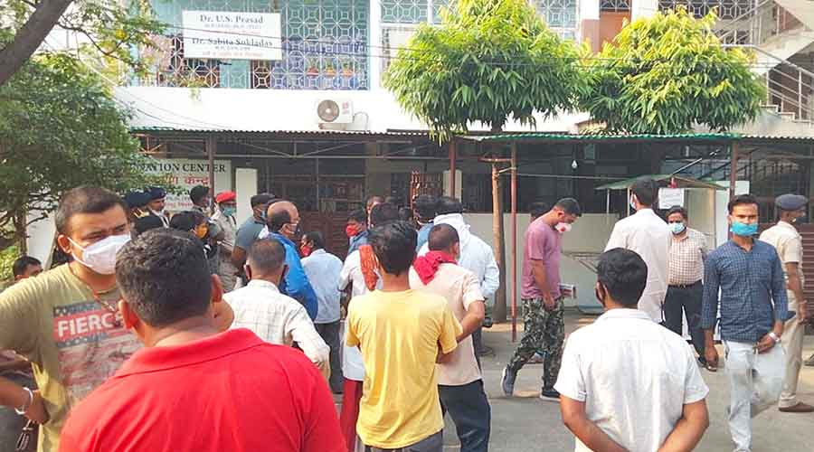 People gathered outside the Raj Clinic at Housing Colony in Dhanbad on Sunday.