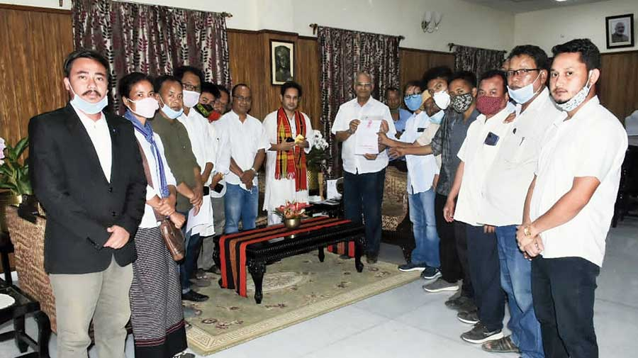 Newly-elected members of the TTAADC meet governor Ramesh Bais under the leadership of Tipra chairman Pradyot Kishore Debbarma at Ujjayanta Palace in Agartala  on Sunday.