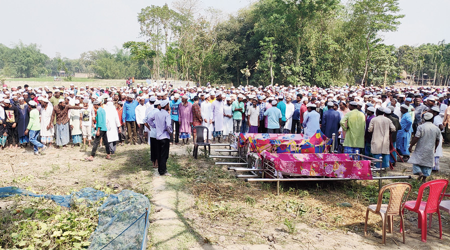 Residents assemble in front of the mortal remains of the four youths at Jorpatki village in Sitalkuchi of Cooch Behar on Sunday.