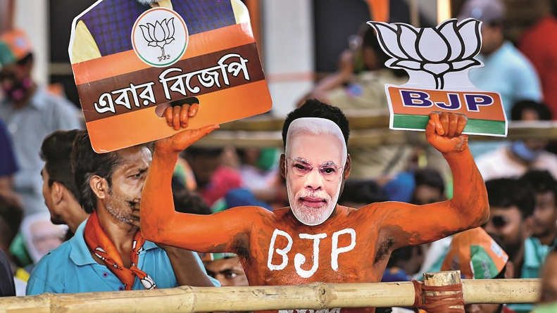 A BJP supporter during Prime Minister Narendra Modi's election campaign in support of BJP candidates for West Bengal Assembly poll at Dumurjola stadium in Howrah district, Tuesday, April 6, 2021.