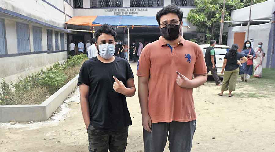 Two young voters after casting their votes at a polling booth in the Bansdroni area, under the Tollygunge Assembly constituency.