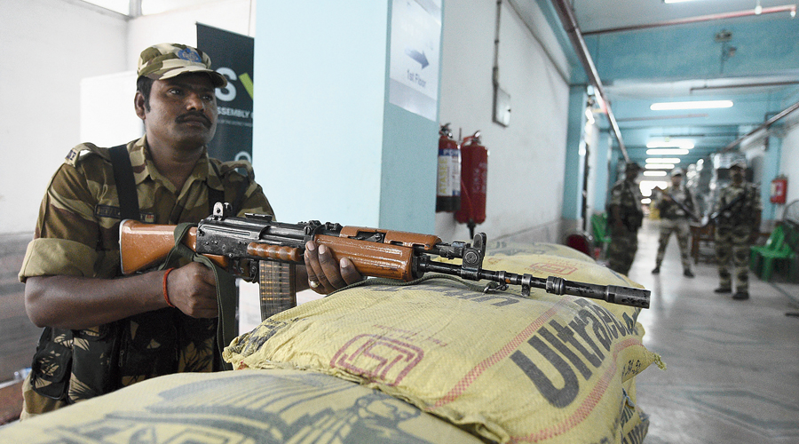 A security person stands guard outside a strong room at Gitanjali stadium in Kasba on Sunday.