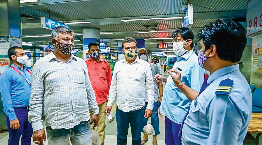 """Metro officials talk to passengers during a """"mask awareness drive"""" at New Garia station earlier this week."""