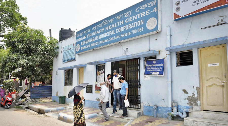 People leave the urban primary health centre at Dattabad on Monday after officials informed them that the centre had no vaccines.