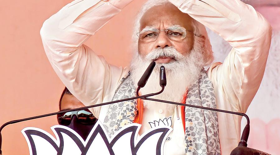 Narendra Modi addresses an election campaign rally in Kalyani  on Monday.