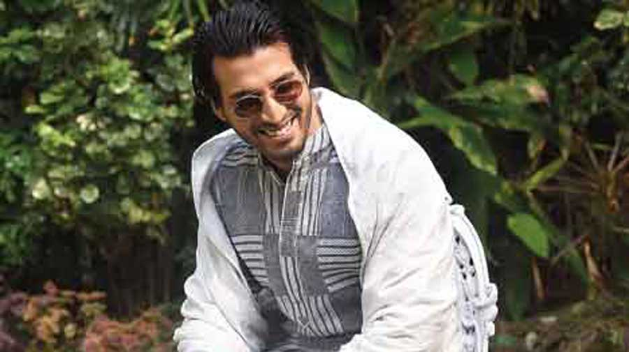 "Effortless and oh-so-cool! While Kutubuddin channels the fiery sexy in a white-on-white two-layered kantha shawl and torn denims, Samrat Ganguly sports a laid-back look in a grey-and-white tussore kantha sherwani, which he also later styled with a shawl for a slightly more formal touch (inset). Iqbal in his tussore bundi waistcoat and red glasses, can rock a brunch as well as a #newnormal meet-up. ""The white shawl on Kutubuddin is the original style of kantha with guri run. Even beyond the motifs there is white-on-white embroidery. Samrat's sherwani has geometric designs and is contemporary,"" says Malika."