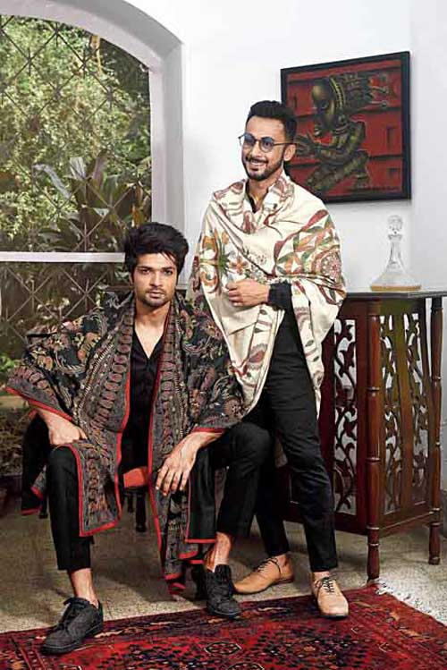 "Make-up pro Abhijit Chanda is in front of the camera this time and he carries off this three-layered nakshi kantha shawl with grace. ""This has guri run. The origin of kantha was two-three layers of it stitched together. They would draw from whatever was around them. Kantha was a quilt. Now kantha has become the stitch. These are the original kantha looks and all of them have the guri run, which is most special for me. It is a colour-on-colour guri run. It takes up to a year to complete a shawl of this kind,"" says Malika. Iqbal too sports a nakshi kantha shawl made dramatic with black shirt and black trouser."