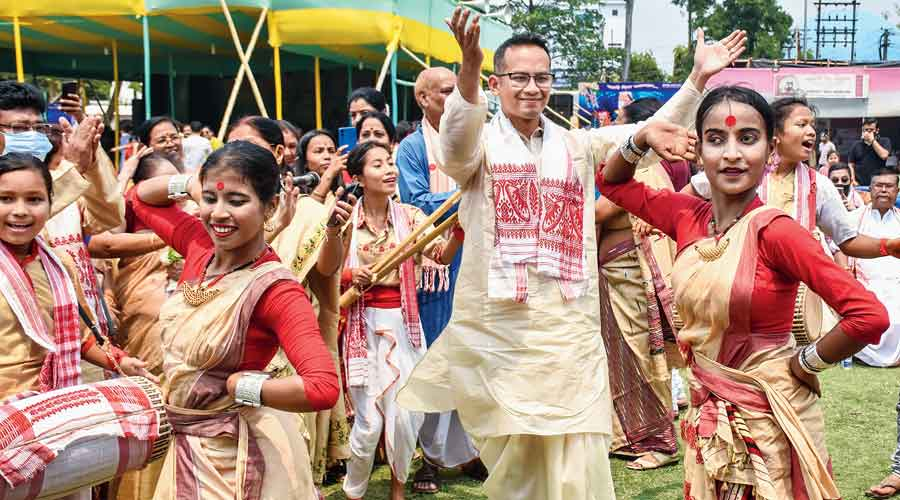 Congress MP Gaurav Gogoi dances with artistes during Rongali Bihu celebrations at Latasil playground in Guwahati on Wednesday
